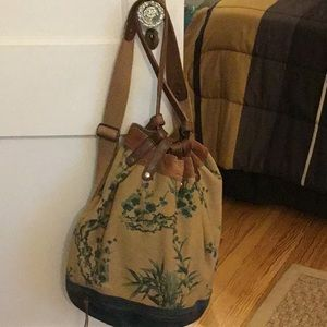 Lucky Brand canvas and suede backpack.
